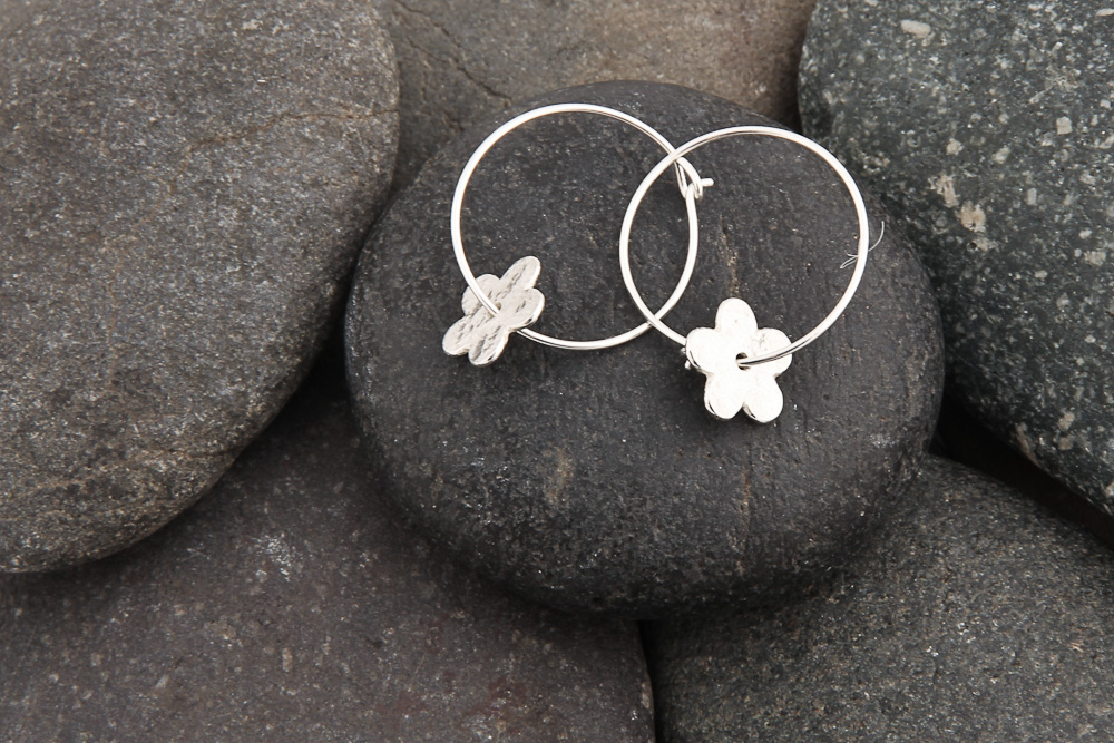 Silver flower on hoops earrings, silver. £27.00