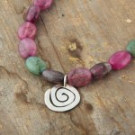 Spiral beaded necklace, hammered silver and tourmaline, £55.00